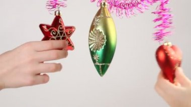 Childrens hands touches christmas-tree decoration — Stock Video