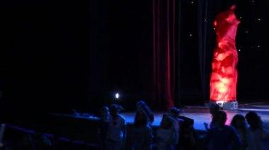 Spectators dance about a scene — Stock Video