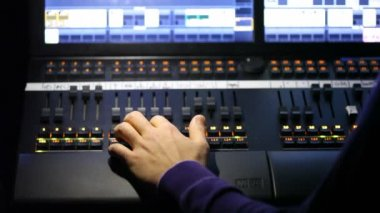 Hand of sound producer moving lie on mixer panel. — Stock Video