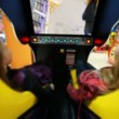 Two girls watch film on motion simulator, screen movie with roller coaster — Vídeo Stock