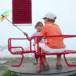 Two children spinning on carousel — Stock Video #28805823