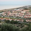 View from hill of costal village, sea and hills has shown — Stock Video