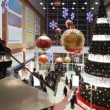 Stock Video: People move near big Christmas tree in shopping mall Golden Babylon