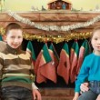 Brother and sister sit parents in front of fireplace — Stock Video