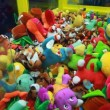 Stock Video: Attempt to win in slot machine for children with many stuffed toys