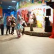 Stock Video: Little children having fun with artificial snow in building