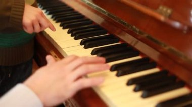 Closeup of hands of father and son playing on piano — Stock Video