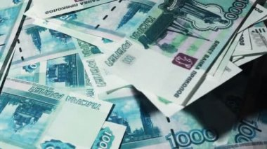 Many banknote thousand rubles turn in two levels — Stock Video