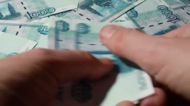 Hand recount many banknote thousand rubles — Stock Video