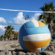 Ball lies on sand under volleyball net at beach — Stock Video