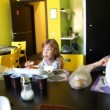 Mother with son and daughter eating at dinning table — Stock Video