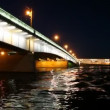 Stock Video: Camermoves under lighted Liteyny Bridge standing on Neva