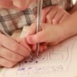 Childrens hands draw something in notebook — Stock Video