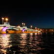 Stock Video: Ship departures from Blagoveshchensky Bridge across night Neva