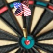 Metalic arrow hit the center of dartboard — Stock Video