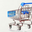 Stock Video: Little metallic toy trolley turning around