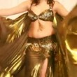 Female belly dancer perform in golden dress — Stock Video