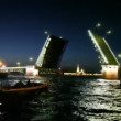 Stock Video: Some boats swim about dissolved palace bridge on Neva