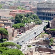 Stock Video: Imperial Forums street leading to the Coliseum, Saint Peters Cathedral dome