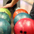 Close-up of bowling balls, man takes ball — Stock Video