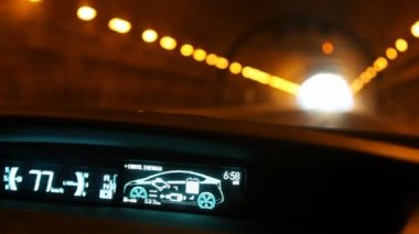 Driving through tunnel in hybrid car Toyota Prius — Stock Video