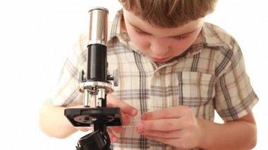 Little boy prepare specimen pouring it on glass slide — Stock Video