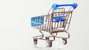 Little metallic toy trolley turning around — Stock Video
