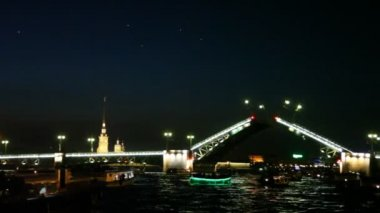 Raised drawbridge at night on Neva illuminated with lights — Stock Video