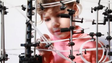 Little girl have fun with space marble run — Stock Video
