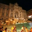 Stock Video: Tourists around Trevi Fountain at evening, people admire impressive art