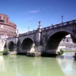 Sant Angelo Bridge at summer, camera moves down the river and go under the bridge — Stock Video