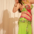 Young female in green perform bellydance — Stock Video