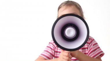 Girl holds loudspeaker directed upward and says into him — Stock Video