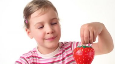 Girl holding timer in the form of strawberries — Stock Video