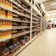 ストックビデオ: Stands with food in hypermarket, panoramfrom left to right