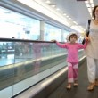 Woman and girl run on speedwalk at airport — Stock Video