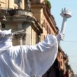 Mummer in white suit of the Statue of Liberty stands and holds torch hand — Stock Video