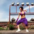 Womperforms modern dance, at background of small wall — Stock Video #28843841