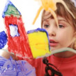 Little girl paint himself at home in picture on transparent glass — Stock Video