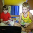 Stock Video: Two boys play a computer game