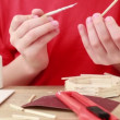 Stock Video: Boy apply glue on stick and attach it to wall of match house