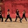 Four girls active dance synchronously and move closer — Stock Video