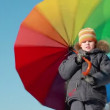 Vídeo Stock: Boy stand and hold umbrella, he spins it by hook handle