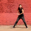Stock Video: Girl in black clothing dance active in modern style