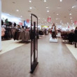 Stock Video: Panoramentrance from control rack in shopping room of clothes