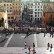 Stock Video: Tourists on Spanish Steps (Italian: ScalinatdellTrinità dei Monti) in Rome