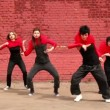 Stock Video: Dance team dance synchronously in modern style, then turn around twice