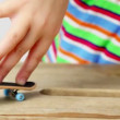 Video Stock: Few simple tricks on fingerboard with two fingers