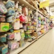 Stands with childrens goods in hypermarket, panorama from left to right — Vídeo Stock