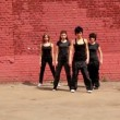 Stock Video: Dance team of four girls start dance synchronously, then fall down